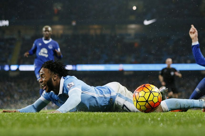 No penalty given, as Manchester City's Raheem Sterling (above) tumbles after coming into contact with Everton defender John Stones with one minute left in their Premier League tie.