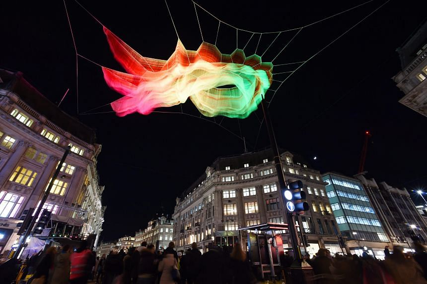 Visitors can walk around the Garden Of Light (above) by French art collective Tilt in Leicester Square. IFO (above) by French artist Jacques Rival. Litre Of Light by British artist Mick Stephenson. American artist Janet Echelman's 1.8 installation ho