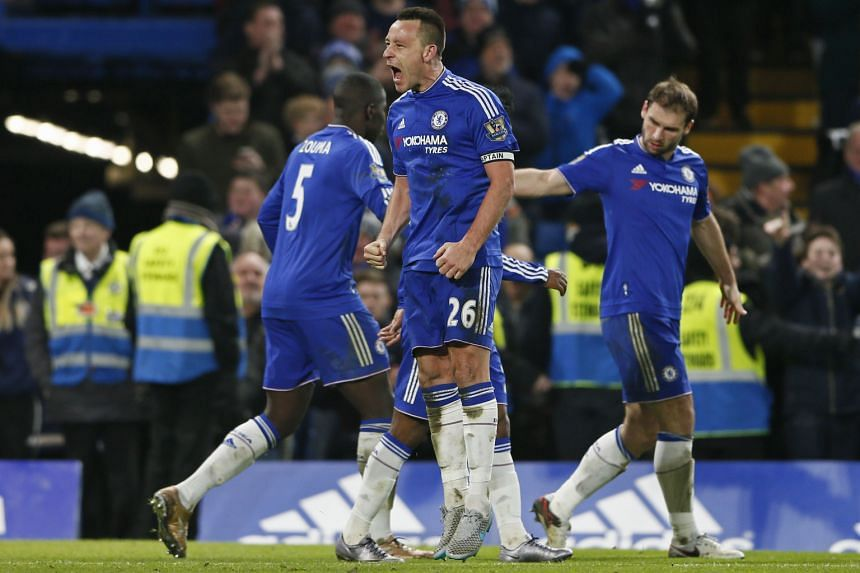 John Terry (left, in blue) in despair after Funes Mori's goal at the start of stoppage time put Everton 3-2 ahead, and (right) celebrating his equaliser, which came in the eighth minute of injury time and from an offside position.