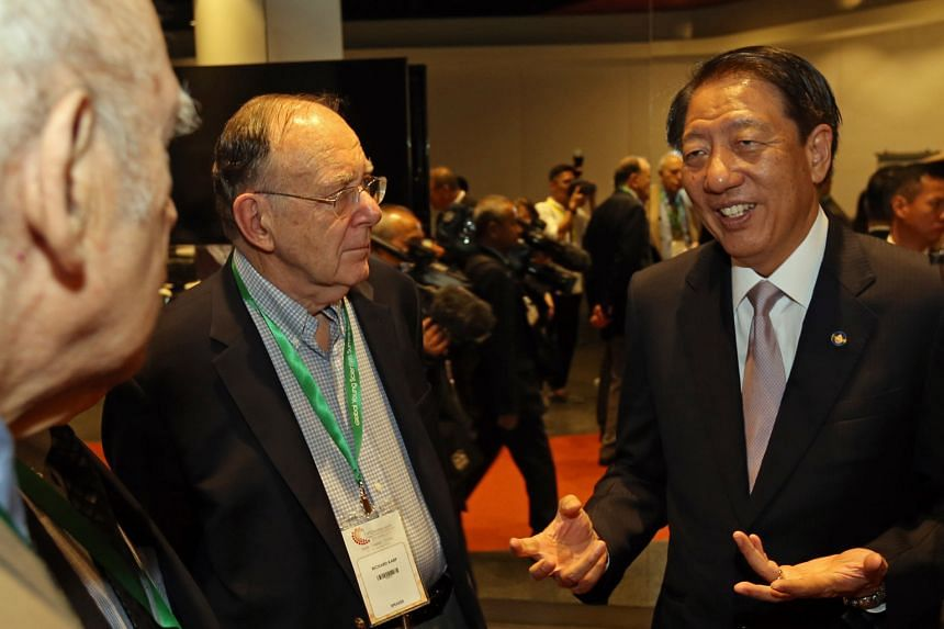 Mr Teo (right) with speakers of the Global Young Scientists Summit 2016, Nobel Prize winner in Physics, Professor Jerome Friedman (left), and Turing Award winner, Professor Richard Karp, at the opening ceremony yesterday.