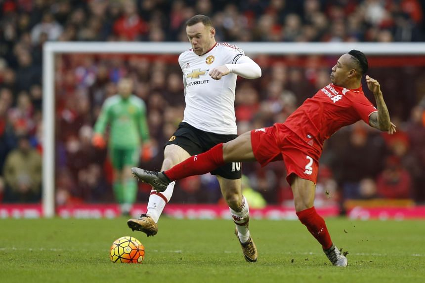 A close-range volley by Manchester United skipper Wayne Rooney (left) in the 78th minute was enough to beat Liverpool, even though they were second-best for much of the clash .