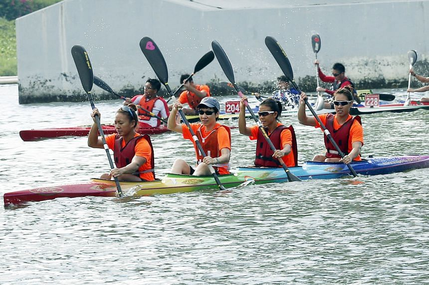 Minister for Culture, Community and Youth Grace Fu (second from left), guest of honour at the Singapore Canoe Marathon, testing out a Junior K4 boat at Marina Reservoir with national canoeists (from left) Stephenie Chen, Suzanne Seah and Sarah Chen -