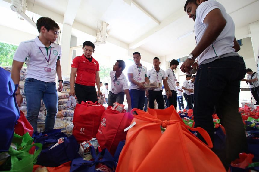 Players and officials from S-League football club Geylang International joined over 800 residents, grassroots leaders and volunteers for the One Community Project at Kembangan-Chai Chee and Geylang Serai constituencies yesterday. The event, aimed at