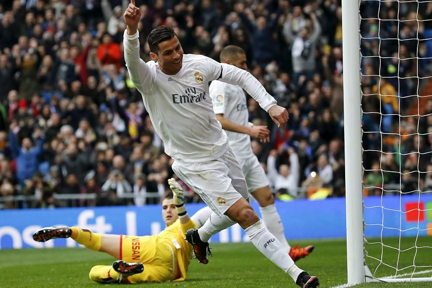 Cristiano Ronaldo celebrating his second goal against Sporting Gijon. Zidane's second match in charge ended 5-1 in favour of Real Madrid.