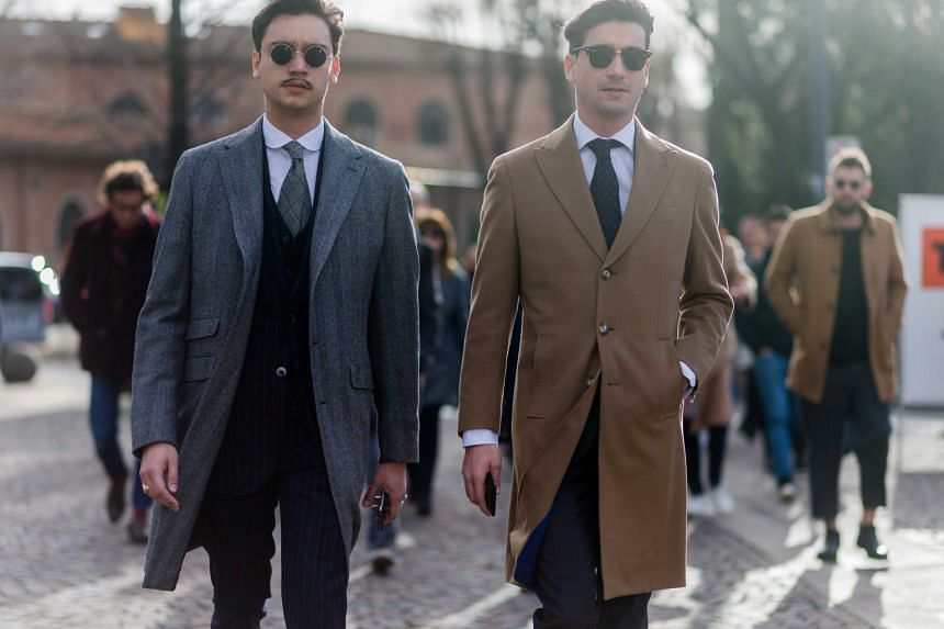 Visitors to the biannual menswear trade summit Pitti Uomo 89 last week in Florence, Italy.