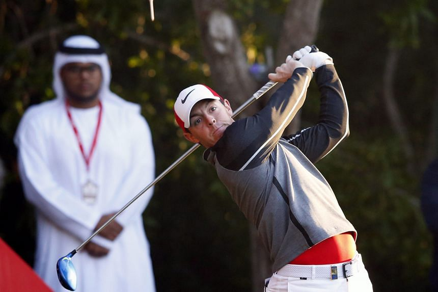 World No. 3 Rory McIlroy teeing off during the first round of the Abu Dhabi HSBC Golf Championship yesterday. The Northern Irishman, returning from an extended break, shot a six-under 66 for joint-third spot and is two strokes clear of world No. 1 Jo