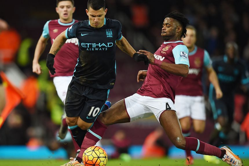 Manchester City's Sergio Aguero (left) challenging West Ham's Alex Song for the ball in the 2-2 draw. Aguero scored both goals and now has 15 goals in 22 matches this term, despite injuries limiting his appearances.