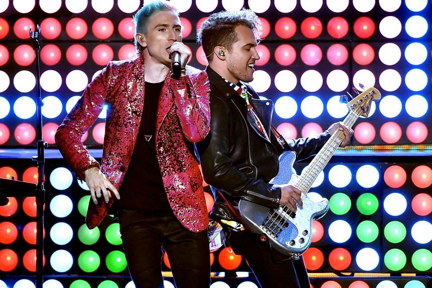 Now That's What I Call Rock features bona fide pop acts, including Walk The Moon, comprising Nicholas Petricca (far left) and Kevin Ray.