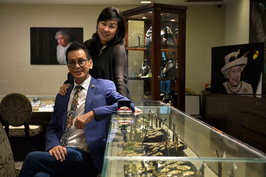 Mr Thomis Kwan and his wife Caroline run Foundation Jewellers, which sells Peranakan-style pieces designed by him as well as contemporary pieces. Queen Elizabeth II (above) wearing Foundation Jewellers' Bird Of Paradise Pendant & Brooch (left) at the