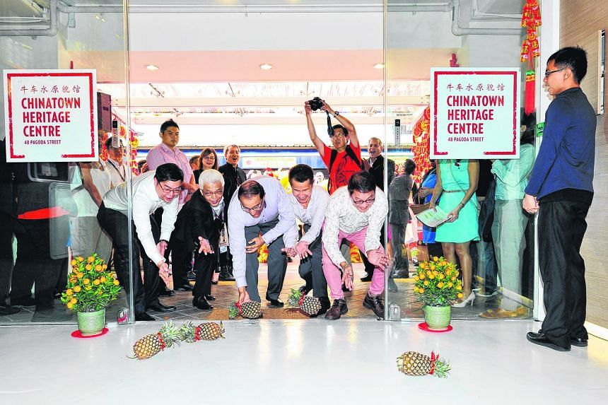 The revamped Chinatown Heritage Centre at 48, Pagoda Street opened its doors yesterday - to five pineapples rolled in by VIP guests for luck and prosperity. Doing the honours were (from left) Chinatown Business Association chairman Bernard Leong, the