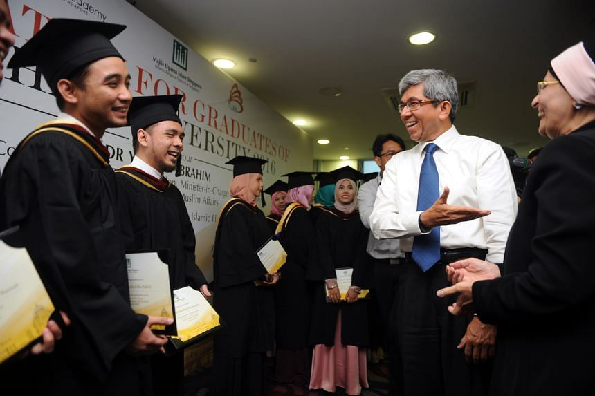 Dr Yaacob with the Egyptian Ambassador to Singapore Fatma F. Galal and the Singaporean graduates of the Al-Azhar University yesterday. Dr Yaacob urged the graduates to practise what they learnt within the context of how Islam is practised in Singapor