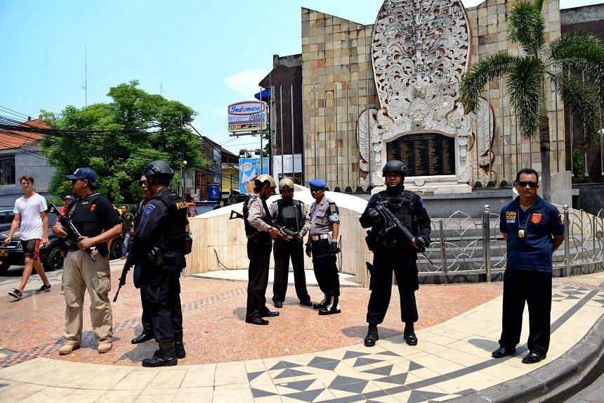 Indonesian police guarding a monument dedicated to those killed in the 2002 Bali bombings in the tourist district of Kuta. A new law is being proposed in the wake of the siege in Jakarta on Jan 14 this year.