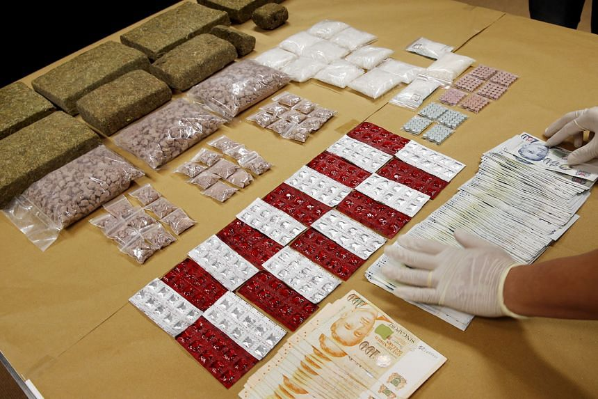 The haul of drugs and cash seized during the four-day operation this week by CNB officers, who carried out islandwide raids, including on budget hotels and nightspots.