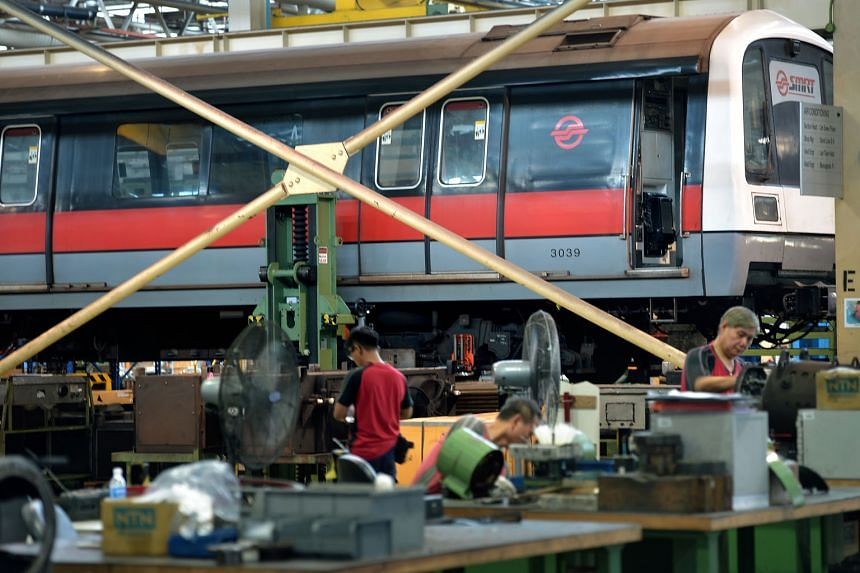 SMRT staff at the Bishan depot working on a train's repairs. Transport Minister Khaw said in Parliament yesterday that it was best to let the engineers do what they need to do to make the Mass Rapid Transit system reliable again.
