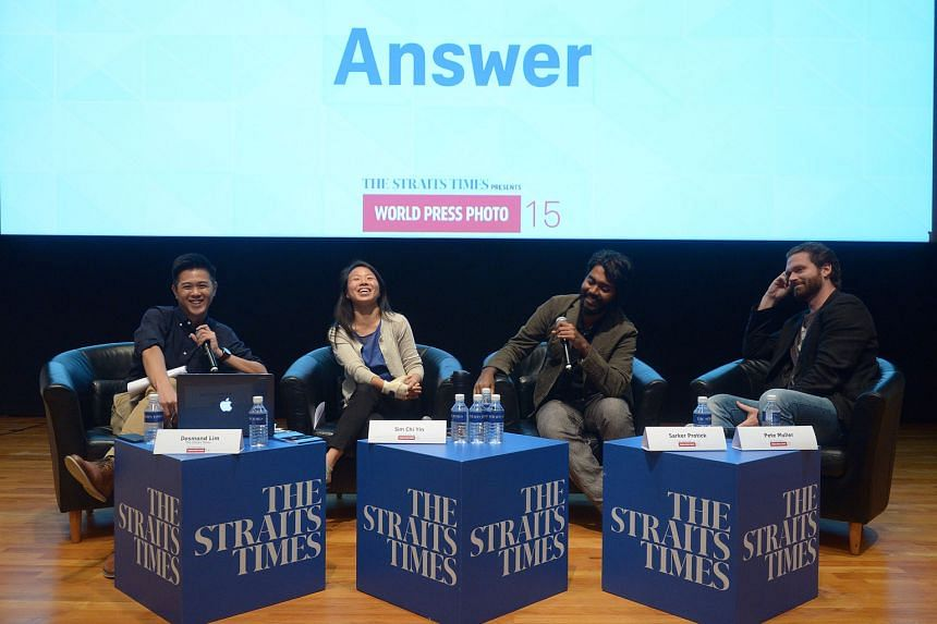 (From left) Moderator Desmond Lim of ST and the photojournalists, Ms Sim, Mr Sarker and Mr Muller, at last night's panel discussion, which was attended by more than 150 members of the public.