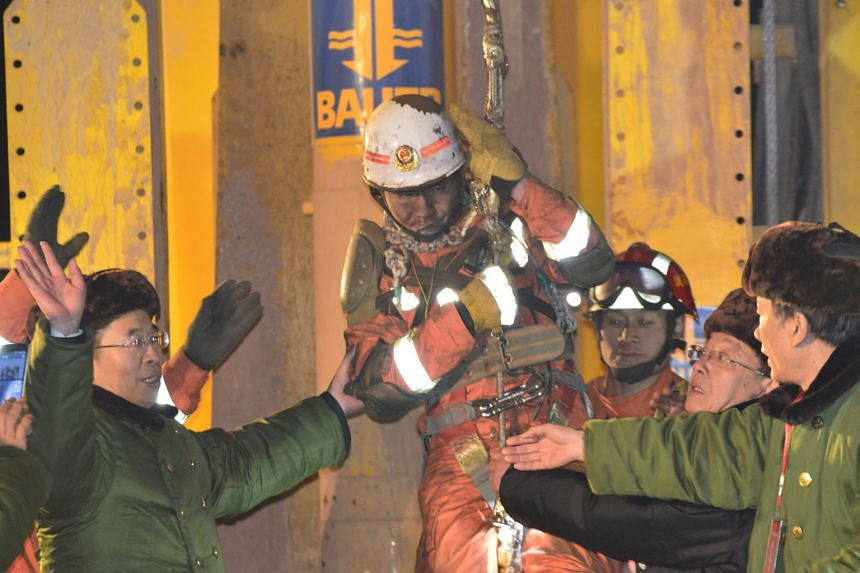 One of the four workers, who had been trapped underground for 36 days, being lifted from a collapsed gypsum mine in Pingyi, Shandong province, last Friday. The four were among 29 trapped when the mine collapsed on Dec 25. Thirteen miners are still mi