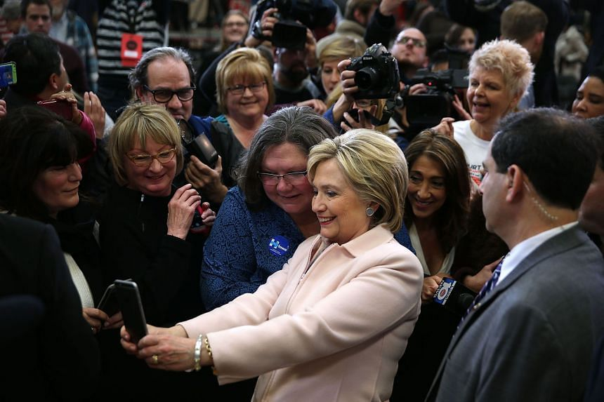 "Democratic presidential candidate Hillary Clinton with her supporters in Iowa on Friday, ahead of the state caucuses. Twenty-two e-mail messages which passed through her private computer server when she was secretary of state have been declared ""top"