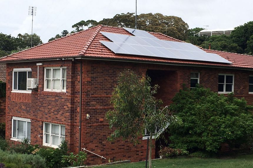 A house with solar panels in Sydney. Almost 16 per cent of homes in Australia use solar power, the highest uptake in the world.