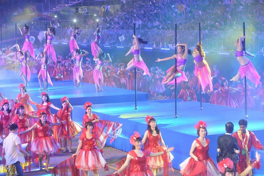 The F1 Pit Building was transformed into an underwater wonderland last night, as 270 performers clad in frilly costumes mimicked colourful marine life such as corals. Part of this year's Chingay National Education show, the fluid dance item was put o