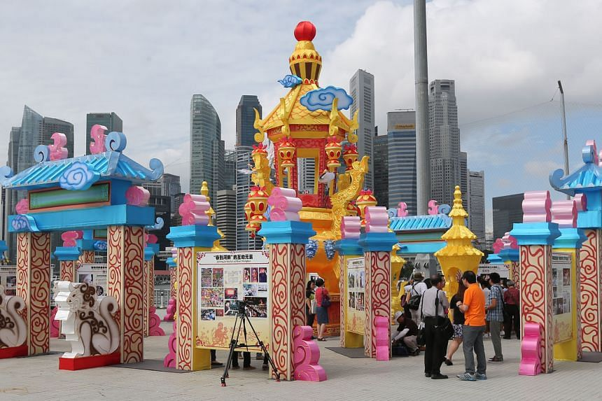The 30 Years Through River Hongbao exhibition is curated by Lianhe Zaobao and features photographs from Singapore Press Holdings and Singapore Federation of Chinese Clan Associations.
