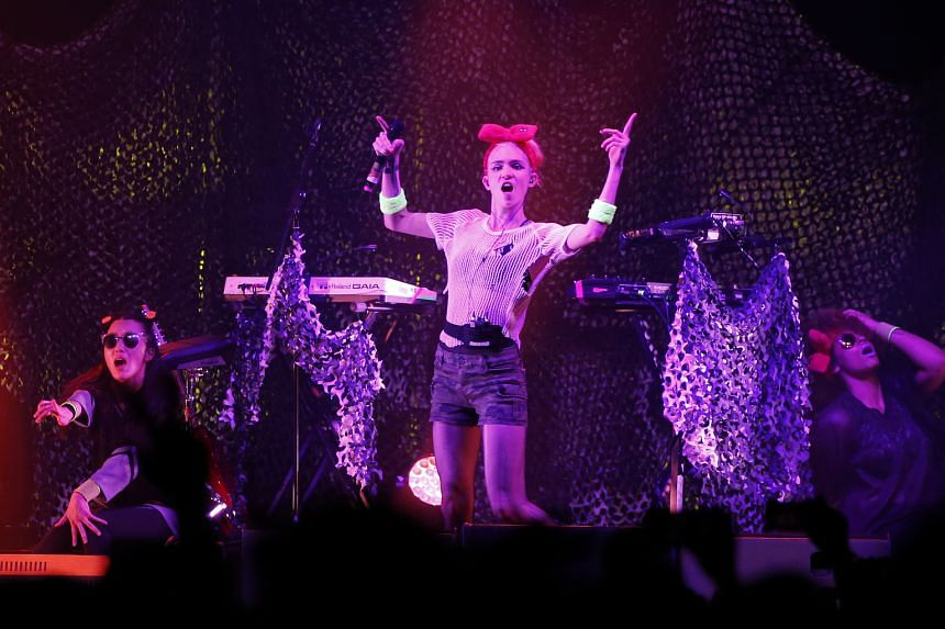 Canadian electronic artist Grimes (centre) delivered an energetic set.