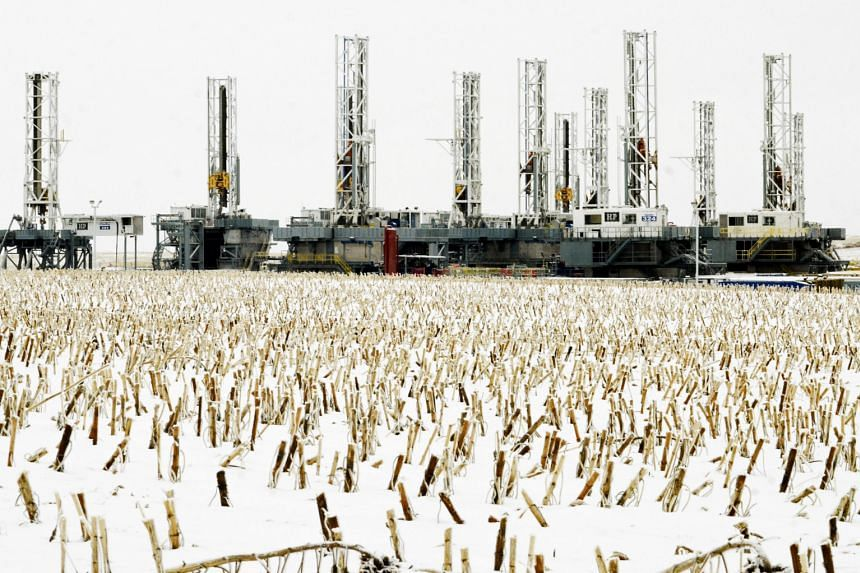 Dormant oil drilling rigs being parked in Dickinson, North Dakota in the United States. Rig-builders are feeling the dramatic repercussions from plunging oil prices, with oil majors continuing to slash capital expenditure while announcing job cuts in