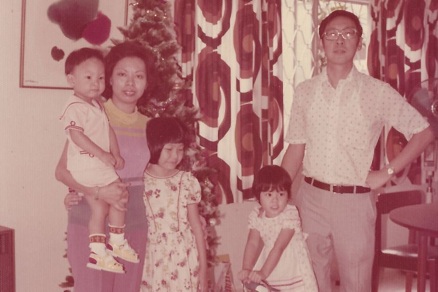 My life so far: Ms Kan with her family, including her mother, Madam Mary Chew, and younger brother, Kenneth, at Christmas in the late 1970s.