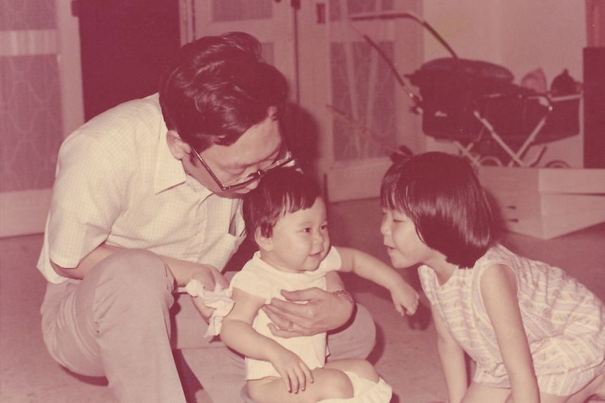 My life so far: Ms Carolyn Kan when she was a baby (above), with her father, Mr Michael Kan, and sister, Geraldine.
