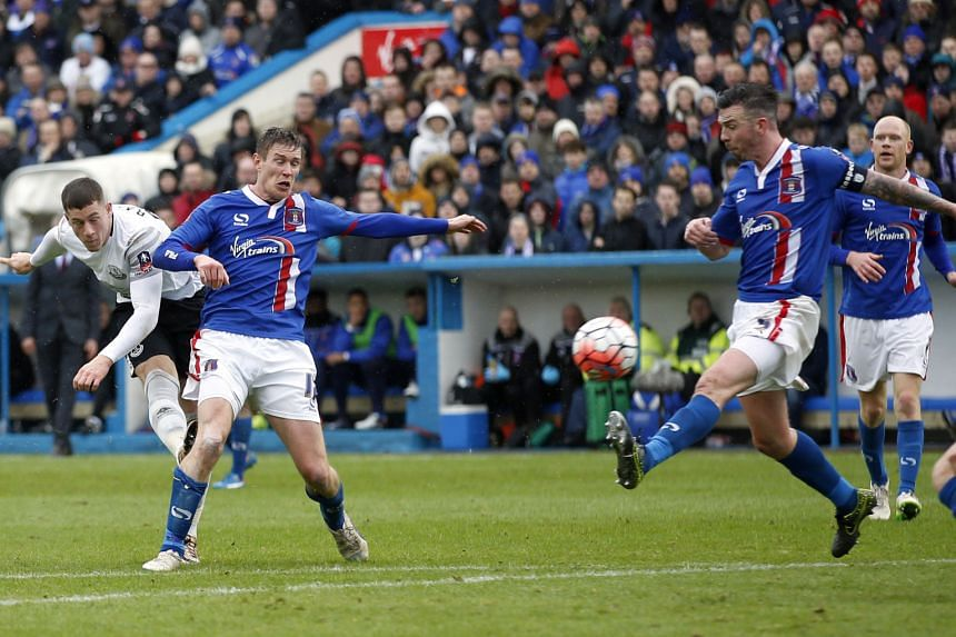 Everton's Ross Barkley (left) wrapping up Everton's 3-0 FA Cup fourth-round victory with his 65th-minute goal at League Two side Carlisle United yesterday. Arouna Kone opened the scoring after two minutes at the fourth-tier side's Brunton Park home b