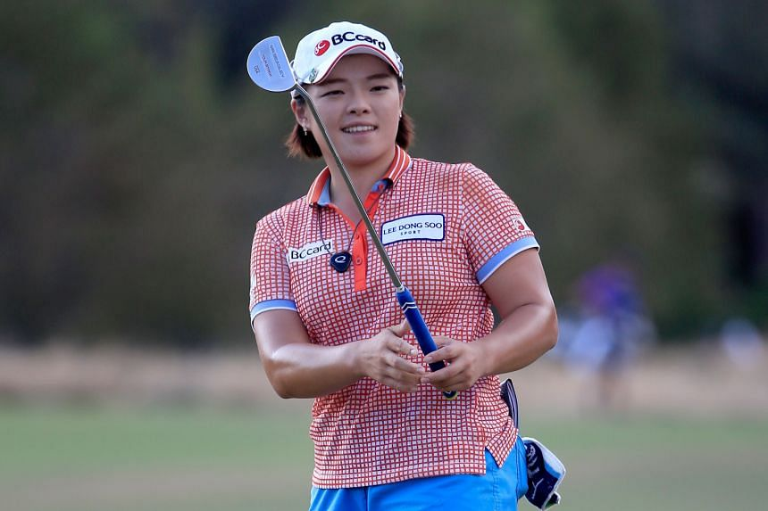South Korea's Jang Ha Na kissed the ground after her albatross on the eighth hole at the Pure Silk Bahamas LPGA Classic on Saturday.