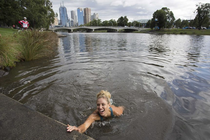 Fresh from her upset win over world No. 1 Serena Williams in the Australian Open women's final, Angelique Kerber honoured a bet by swimming in the Yarra River beside Rod Laver Arena yesterday.