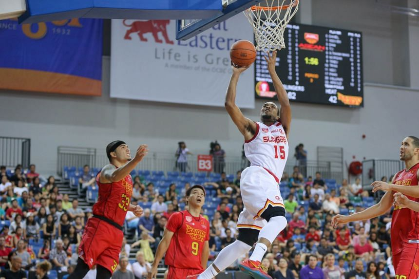 The Singapore Slingers' American import Xavier Alexander (in white) attempting a shot during an Asean Basketball League (ABL) game against the Saigon Heat yesterday. The Slingers beat their opponents 84-69 to extend their winning streak in the ABL to