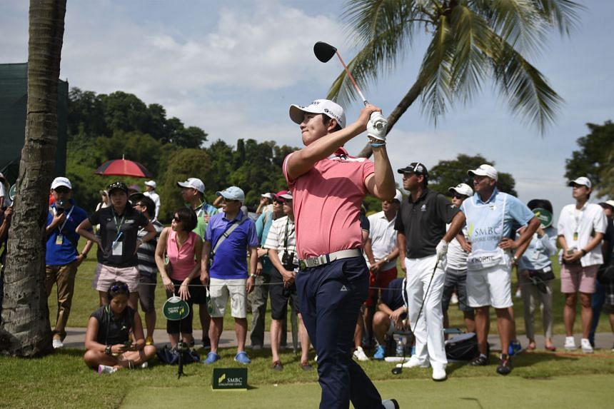 Song Young Han of South Korea teeing off at the fourth hole yesterday during the final round of the SMBC Singapore Open at Sentosa Golf Club's Serapong Course. Victory today would make him the first Korean to win the tournament.