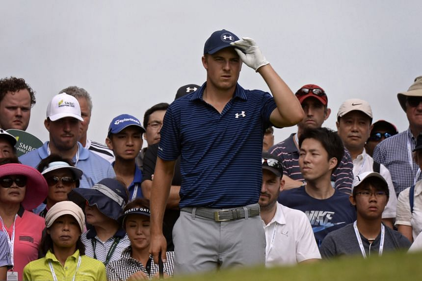 "Jordan Spieth of the USA, playing his sixth overseas tournament in nearly four months, preparing to tee off at the third hole yesterday. A reflective Spieth said he was ""trying to do too much""."