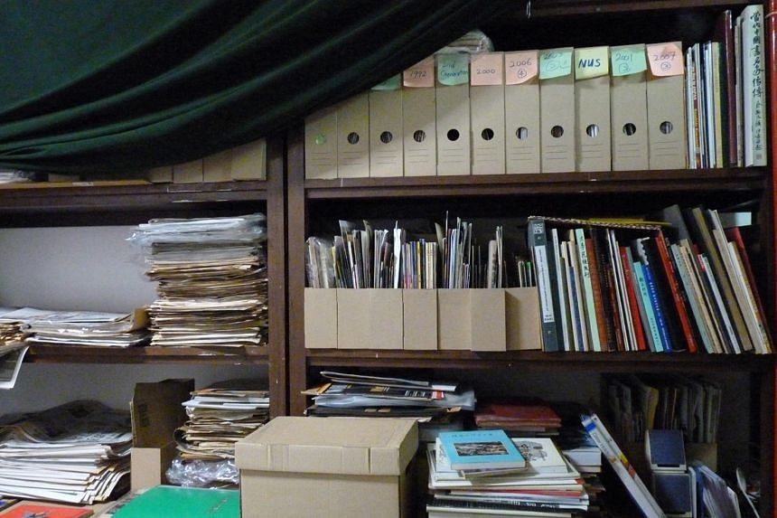 Archivist Koh Nguang How stores his collection in his flat (above), commercial storage space and his mother's home.