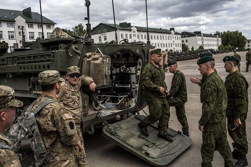 Lithuanian soldiers inspecting a Stryker armoured vehicle belonging to the Pennsylvania National Guard during military exercises in Lithuania last year. The US plans on paying for additional weapons with a budget request of more than $4.8 billion for