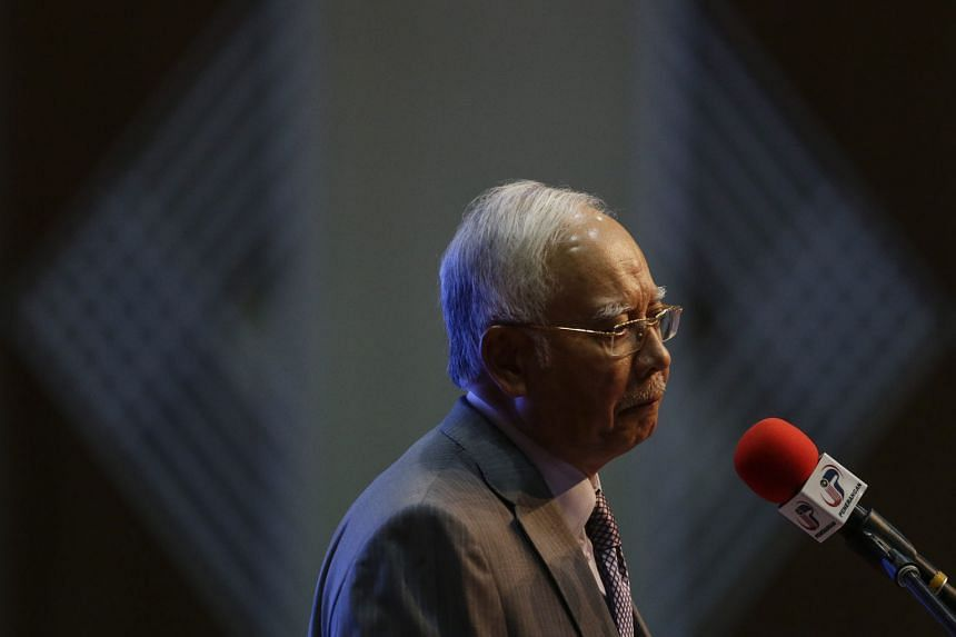 Former law minister Zaid Ibrahim and former Umno branch leader Khairuddin Abu Hassan separately launched complaints to the court and anti-corruption agency, calling for a probe of Prime Minister Najib Razak (left) over the 1MDB saga.