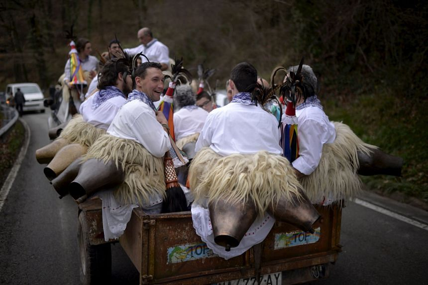 Dancers known as Joaldunak on their way to a neighbouring village during carnival celebrations in Ituren, northern Spain, on Monday. The bell-carrying dancers from Zubieta and neighbouring Ituren visit each other's villages and perform a ritual dance
