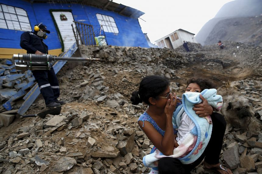 "Residents waiting outside while their homes were fumigated as part of a campaign against the Zika virus and other mosquito-borne diseases on the outskirts of Lima in Peru on Monday. WHO chief Margaret Chan noted that it was ""strongly suspected but no"