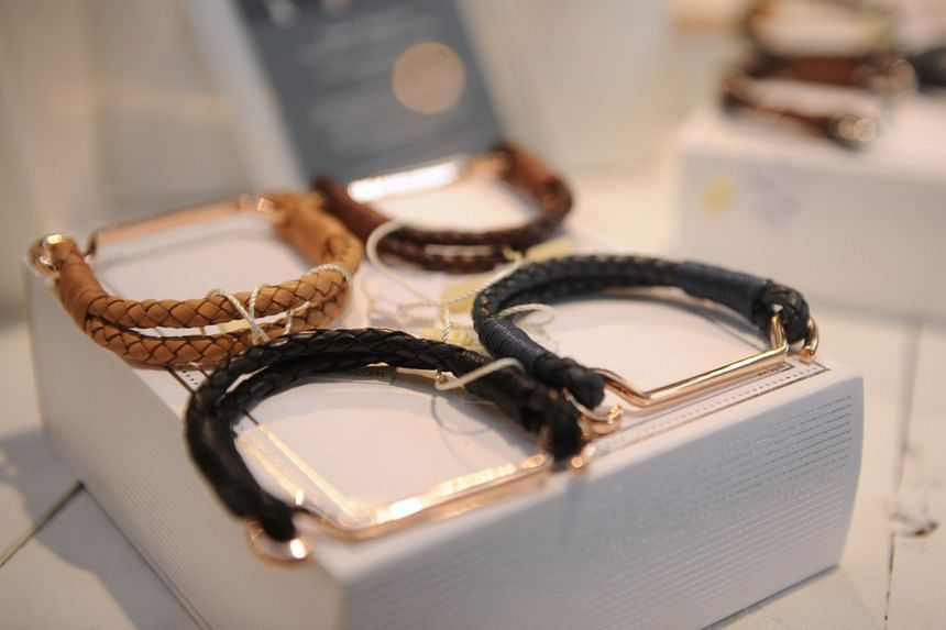 The capsule collection by designer Carolyn Kan (left) to mark the 10th anniversary of Hong Kong lifestyle store Kapok offers accessories such as leather bracelets (above).