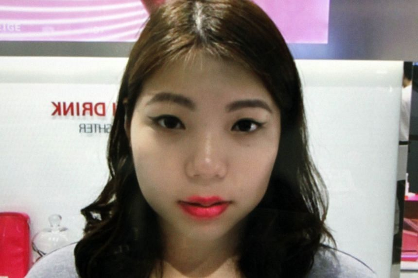 The writer tries the Laneige Beauty Mirror (left) and how she looked with her virtual makeover (above).