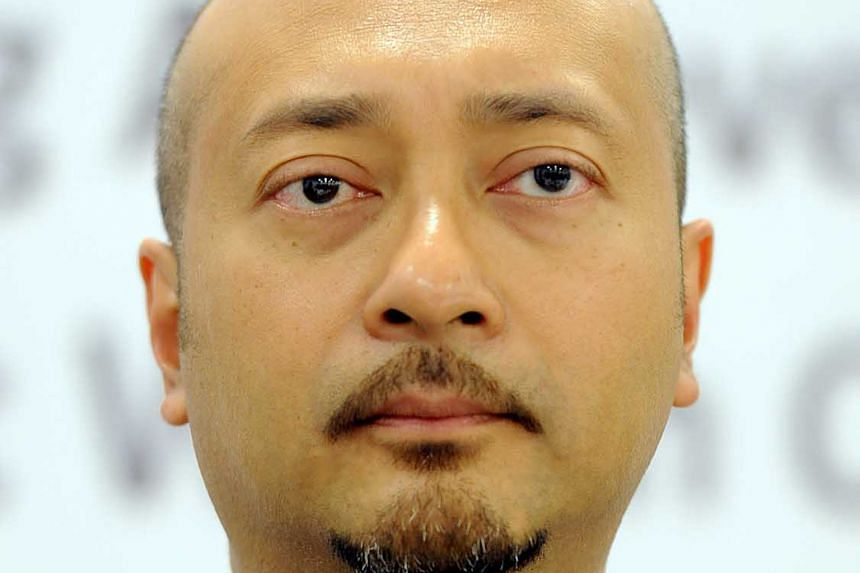 """Datuk Seri Mukhriz Mahathir (above) insists he remains loyal to Umno, but he took a parting shot at PM Najib Razak, describing him as """"childish"""", and saying the real reason he was ousted was that he had been critical of the troubles involving state i"""