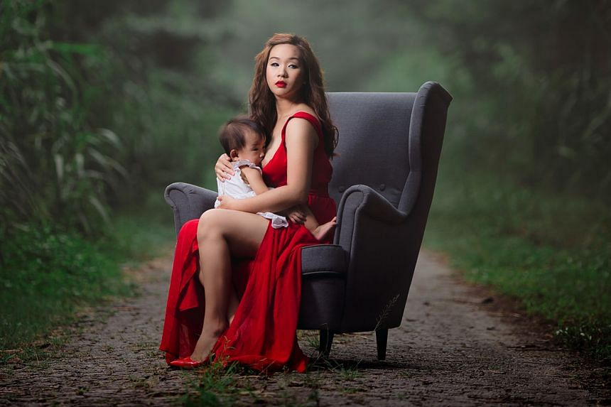 Photographer Ms Pan started with photos of a young mother dressed as a goddess (above) nursing her child in a forest. Ms Pan's second series, featuring Ms Goh in office attire (left) breastfeeding in Raffles Place, was meant as a statement against wo
