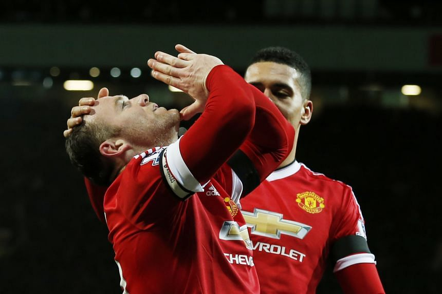 Wayne Rooney celebrating his goal - United's third of the night - against Stoke City. United had not scored three goals at home since Sept 26.