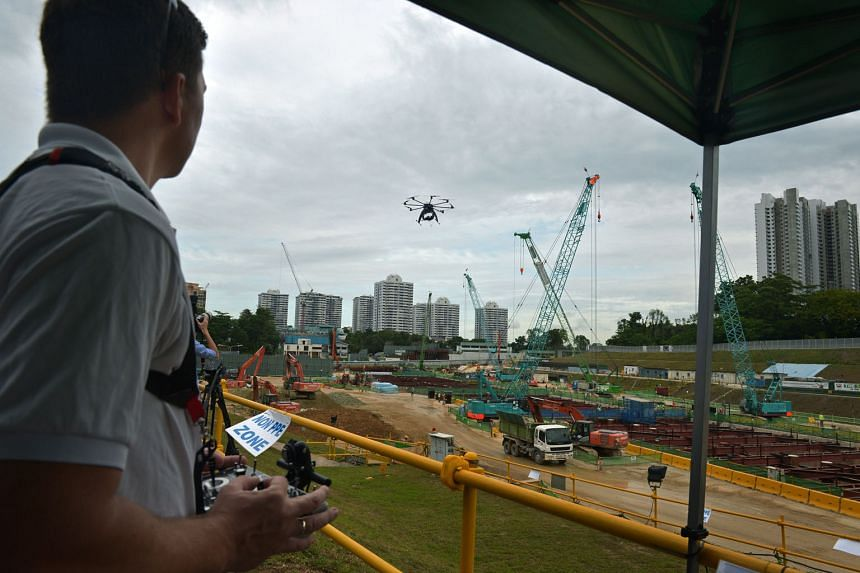 Mr Philip Von Meyenburg of Aetos flying a drone as part of an inter-agency collaboration on the use of unmanned aircraft systems for inspecting construction sites. Various agencies can indicate what they want to look out for and inspect, cutting down
