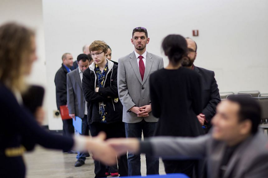 Job seekers at a career fair in Seattle, Washington, last week. The rise in the number of Americans filing for unemployment benefits last week signalled that the United States labour market may be losing some momentum.