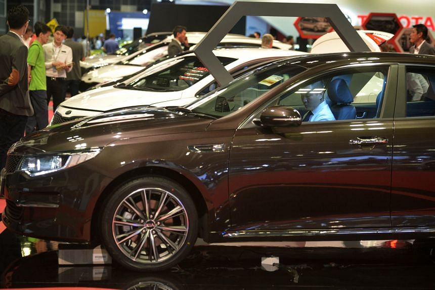 Visitors to the Singapore Motorshow 2016 at Suntec Convention and Exhibition Centre last month. Start checking out the cars you fancy, but weigh various factors with care before committing.