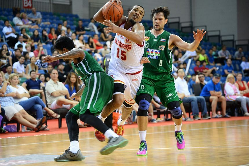 The Slingers' Xavier Alexander being guarded by two Bangkok City players as he drives to the basket. Despite last night's loss, the Slingers stayed top of the Asean Basketball League.