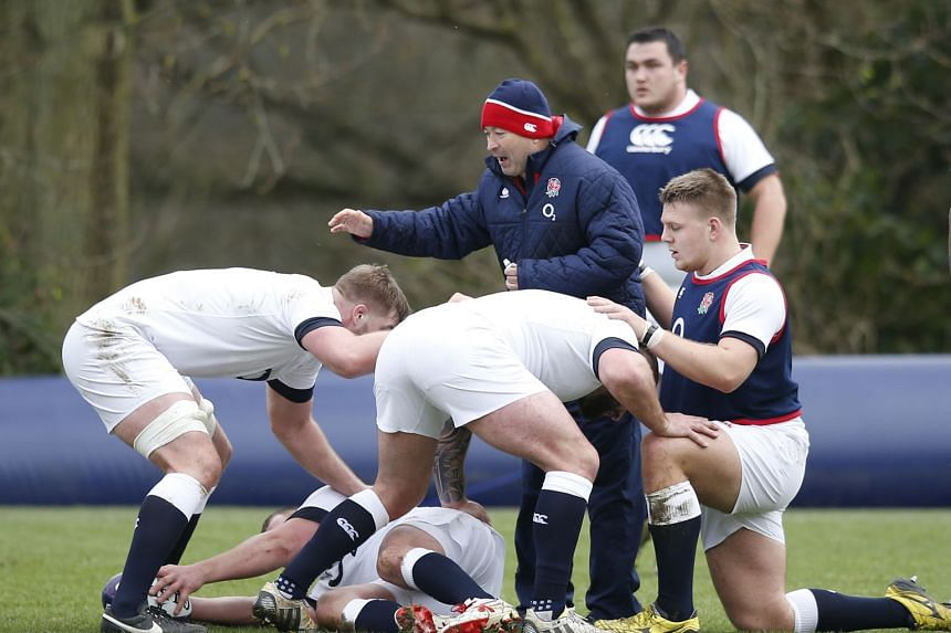 New England head coach Eddie Jones drilling the forwards during training on Thursday. Much is expected of him and new skipper Dylan Hartley as the team bid to redeem themselves after becoming the first World Cup hosts to fail to make the knockout pha