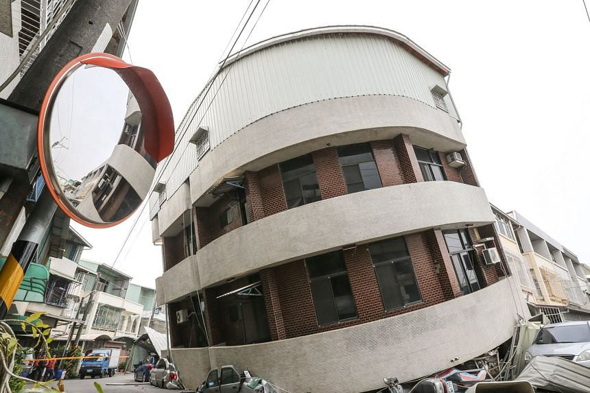 More than a dozen buildings in Tainan, a city of two million people, collapsed during yesterday's quake. Five others were left tilting at alarming angles, a government emergency centre said, as the lower floors buckled during the violent shaking that